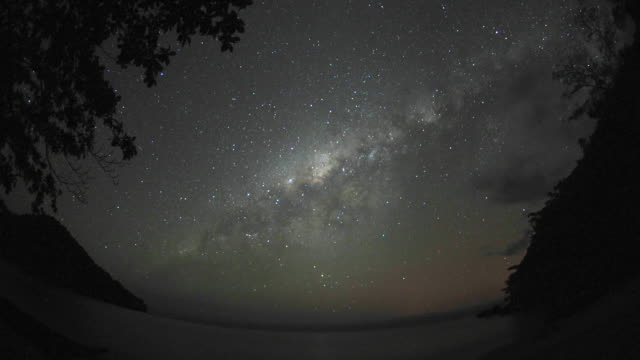 stars and milky way drift through night sky, marojejy, madagascar - fish eye lens stock videos & royalty-free footage