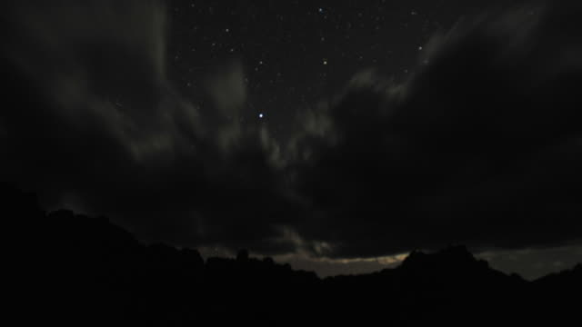 "vidéos et rushes de stars and moon in night sky set behind rocky ridge, andringitra, madagascar - ""bbc natural history"""