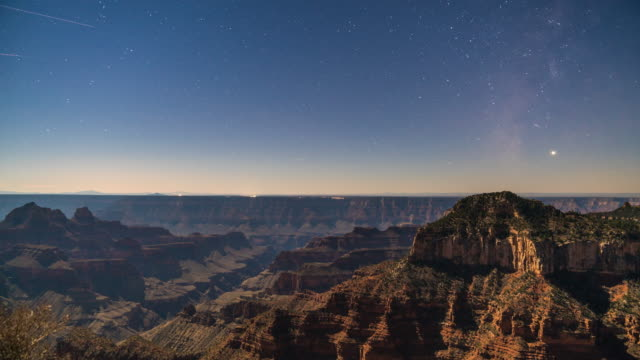 vídeos de stock e filmes b-roll de stars and planes over the grand canyon - grand canyon national park