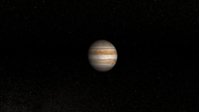 Stars and planets twinkle around Jupiter.