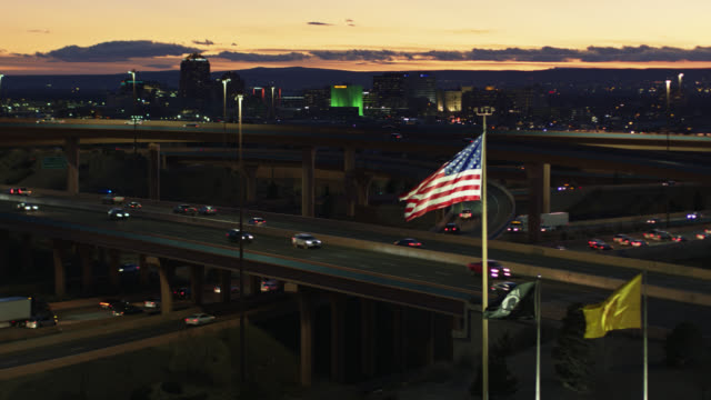 stars and stripes flying in front of albuquerque skyline at sunset - drone shot - new mexico stock videos & royalty-free footage