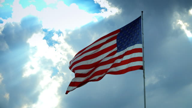 stars and stripes flying in wind from back - pledge of allegiance stock videos & royalty-free footage