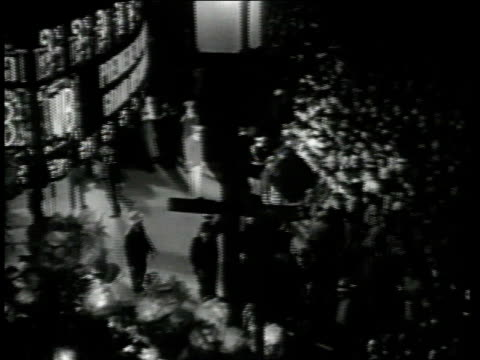 1947 montage stars arrive at theater for movie premiere / hollywood, california, united states - premiere stock videos & royalty-free footage