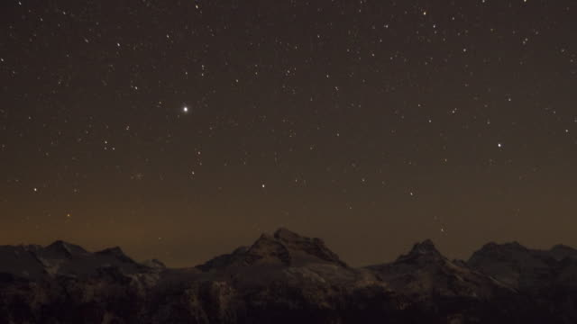 stars at night and snow covered mountains in winter. - time-lapse - canada stock videos & royalty-free footage