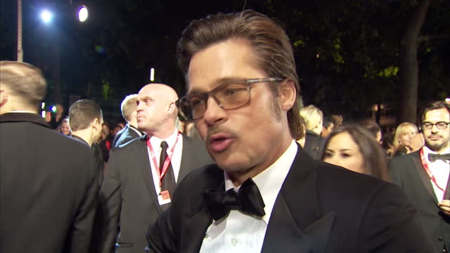 Stars attend the premiere of Fury in Leicester Square Shows exterior shot Brad Pitt answering questions on filming Fury on the red carpet on October...