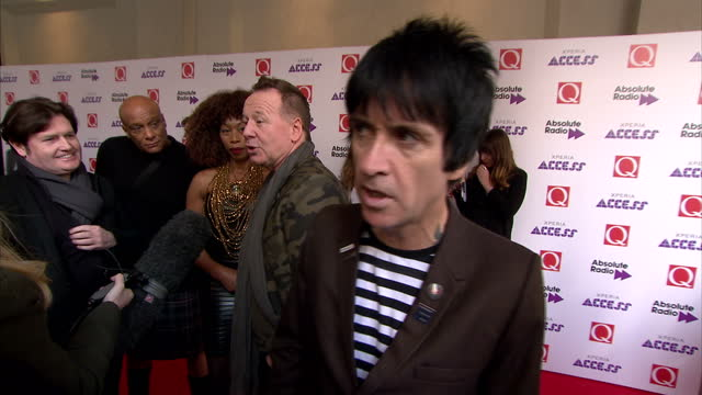 stars attend the q awards at the grosvenor house shows interior shots johnny marr answering questions about pop music and what music he dislikes on... - ジョニー マー点の映像素材/bロール