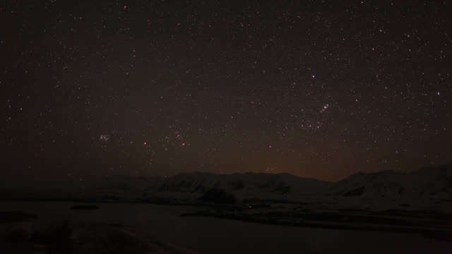 Stars drift in the sky above Lake Tekapo in New Zealand.