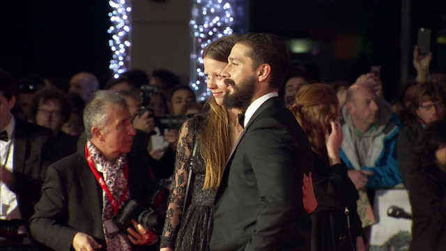 stars of fury attend premiere of brad pitt's new film fury. shows exterior shots shia le beouf on red carpet posing for pictures with mia goth. on... - shia labeouf stock videos & royalty-free footage