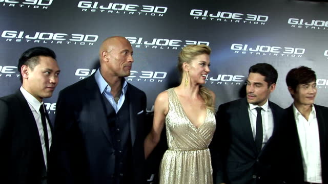 stars of the movie gi joe retaliation received an ear splitting welcome from noisy fans when they attended the sydney premiere dwayne johnson who... - adrianne palicki stock videos and b-roll footage