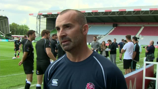 Stars play charity match ENGLAND London Twickenham Stoop EXT Various of Rugby Aid players towards Various of players training on pitch Louie Spence...
