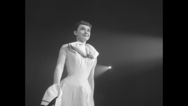 stars put on fashion show for the 1952 march of dimes campaign at the waldorf astoria hotel. among the guests of honor is mrs douglas macarthur.... - audrey hepburn stock videos & royalty-free footage