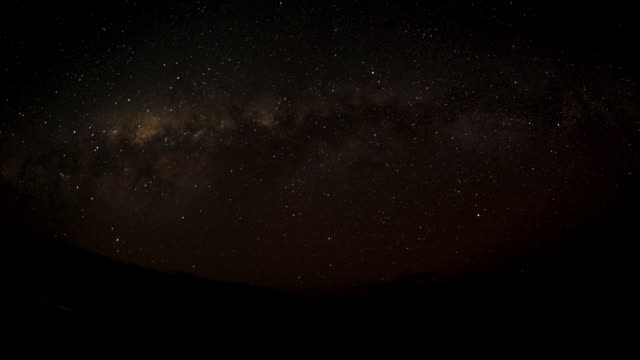stars set as sun rises over ocean, anjajavy, madagascar - stimmungsvoller himmel stock-videos und b-roll-filmmaterial
