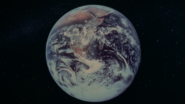 stars surround the earth in space. - galaxy stock videos and b-roll footage