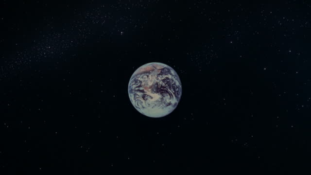 stars surround the earth in space. - motion graphics stock videos & royalty-free footage