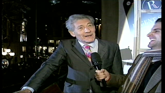stars switch on christmas lights in london's oxford street sir ian mckellen as next to hargravep ointing to light switch interview sot there are 3 of... - ian mckellen stock videos and b-roll footage