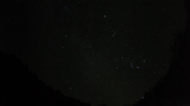 stars wheel through night sky over tolma. - constellation stock videos & royalty-free footage
