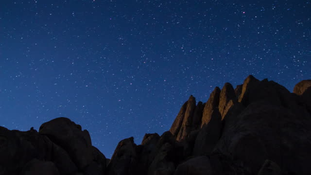 stars wheeling over desert rocks - time lapse - rock formation stock videos & royalty-free footage