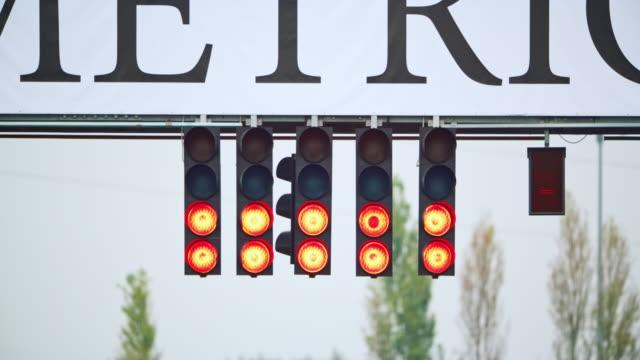 start lights signalling the start of the formula race - illuminated stock videos & royalty-free footage