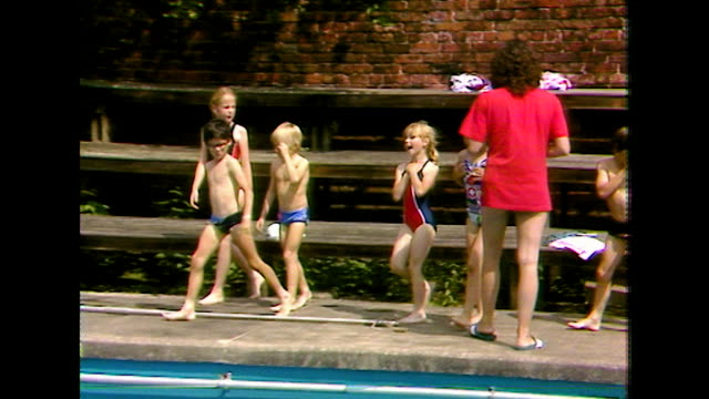 start of children's outdoor swimming lesson; 1984 - swimming costume stock videos & royalty-free footage