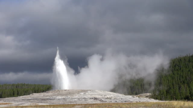start of faithful steam on a cloudy day - old faithful stock videos & royalty-free footage