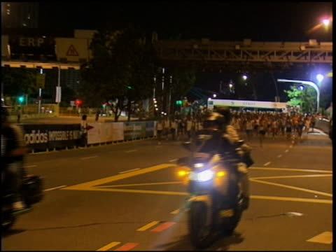 start of the 2010 singapore marathon and runners on course singapore marathon start and runners on course on april 05 2010 in singapore singapore - salmini stock videos and b-roll footage