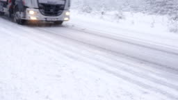 Start of winter, driving on snow-covered road