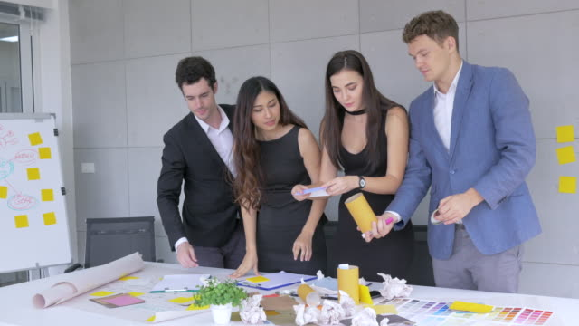 start up team, young businessman and businesswoman brainstoming new product in office - employee engagement stock videos & royalty-free footage