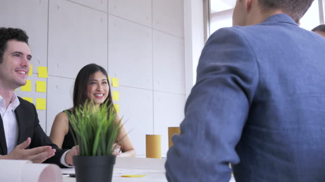start up team, young businessman and businesswoman meeting brainstoming and creative new product or new business in office - employee engagement stock videos & royalty-free footage