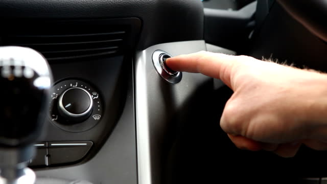 starting a car with an electric start button - start button stock videos & royalty-free footage