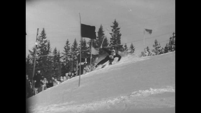 cu starting gate pans down to skier starting slalom run in men's slalom event at winter olympics / various shots of skiers starting slalom run at... - slalom skiing stock videos & royalty-free footage