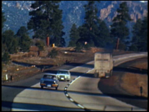 stockvideo's en b-roll-footage met starting line for 1962 mobil economy run; a buick is driving through it / tracking shot of 1962 amc rambler american front quarter driver side... - quarter