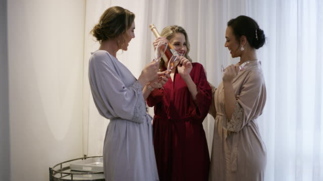 starting off the wedding day on a bubbly note - bathrobe stock videos & royalty-free footage