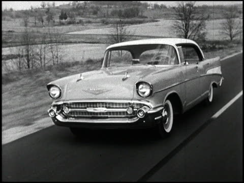 starting with a closeup of a hand turning the key in the ignition this montage shows several outstanding shots of a '57 chevrolet 4door hard top... - chevrolet stock videos & royalty-free footage