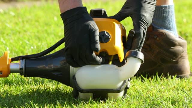 startup gardening machine - halsreif stock-videos und b-roll-filmmaterial