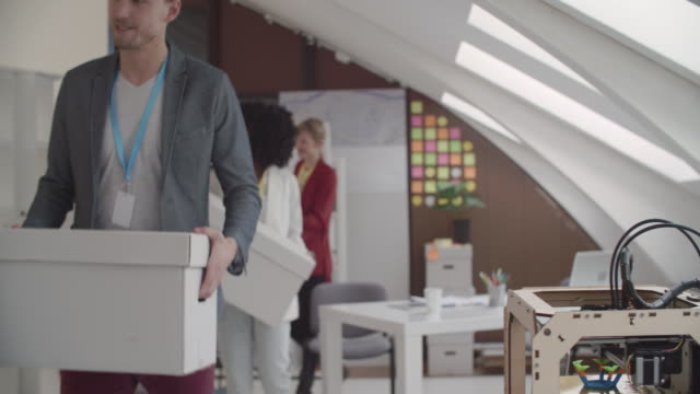 start-up team moving their office. - moving office stock videos and b-roll footage