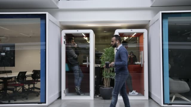 startupers isolate themselves in a telephone booth at station f, world s biggest startup campus on march 5, 2020 in paris, france. - modern stock videos & royalty-free footage