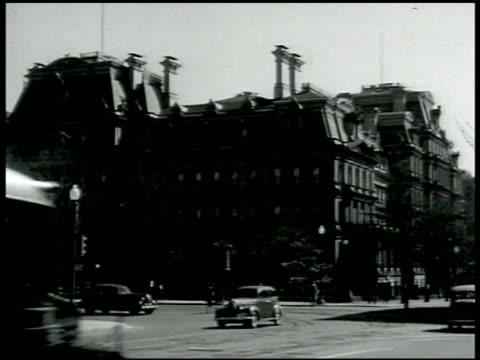 state department building w/ traffic passing fg. int office w/ state department men sitting. secretary of state cordell hull sitting w/ summer wells. - 1942 stock videos & royalty-free footage