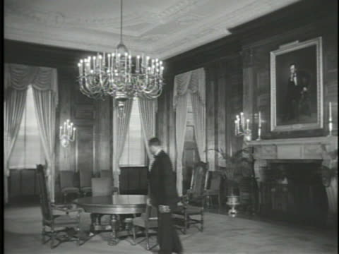 state dining room w/ english oak paneling male staff member adjusting chair ha cu silver plated chandelier ws mckim carved marble mantel w/ painting... - george washington painting stock videos and b-roll footage