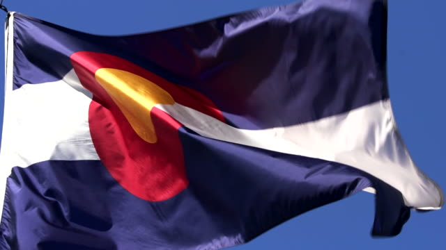 state flag of colorado waving in the breeze - 4k/uhd - red rocks stock videos and b-roll footage