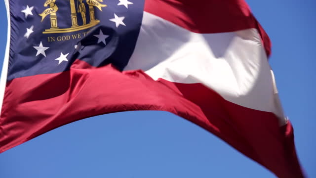 state flag of georgia waving in the breeze - 4k/uhd - georgia us state stock videos & royalty-free footage