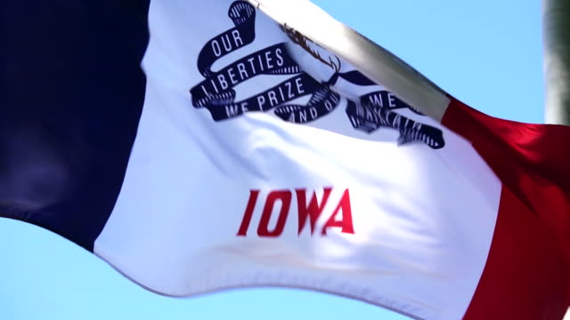 state flag of iowa waving in the breeze - 4k/uhd - flag stock videos & royalty-free footage