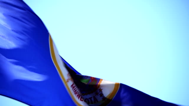 state flag of minnesota waving in the breeze - 4k/uhd - minnesota stock videos & royalty-free footage