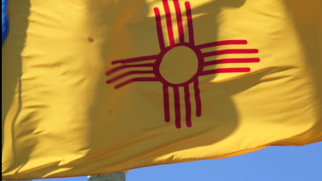 state flag of new mexico waving in the breeze - 4k/uhd - santa fe new mexico stock videos & royalty-free footage