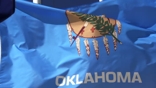 State Flag of Oklahoma waving in the breeze - 4k/UHD