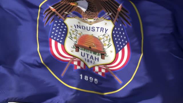 State Flag of Utah waving in the breeze - 4k/UHD