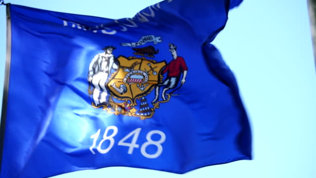 state flag of wisconsin waving in the breeze - 4k/uhd - flag stock videos & royalty-free footage