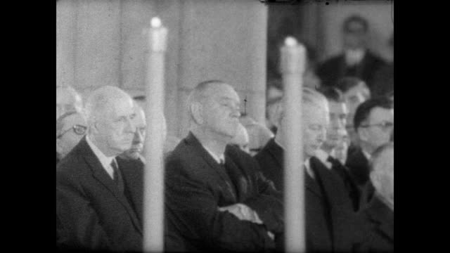 state funeral for german chancellor konrad adenauer at cologne cathedral / ext cologne cathedral / large group of attendees finding their pews inside... - charles de gaulle stock videos and b-roll footage