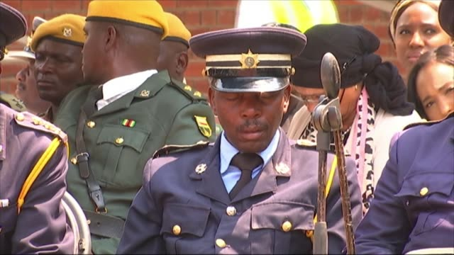 state funeral of robert mugabe held in harare national stadium zimbabwe harare zimbabwe national sports stadium ext man in uniform sleeping in... - sleeping stock videos & royalty-free footage