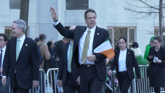 ny state governor andrew cuomo greets parade goers at the 2016 st patrick's day parade on 5th avenue in manhattan - andrew cuomo stock videos and b-roll footage