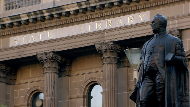 ms state library 'victoria' with statue / melbourne, victoria, australia - statue stock videos and b-roll footage
